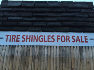 closeup of tire shingles with sale sign